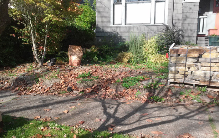 seattle front yard needs landscaping with rock retaining wall and raised planter boxes