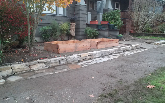 seattle construction of rock retaining wall and raised planter boxes